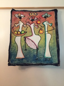 Caribbean art Haitian painting depicting three stylised female figures with baskets of fruit