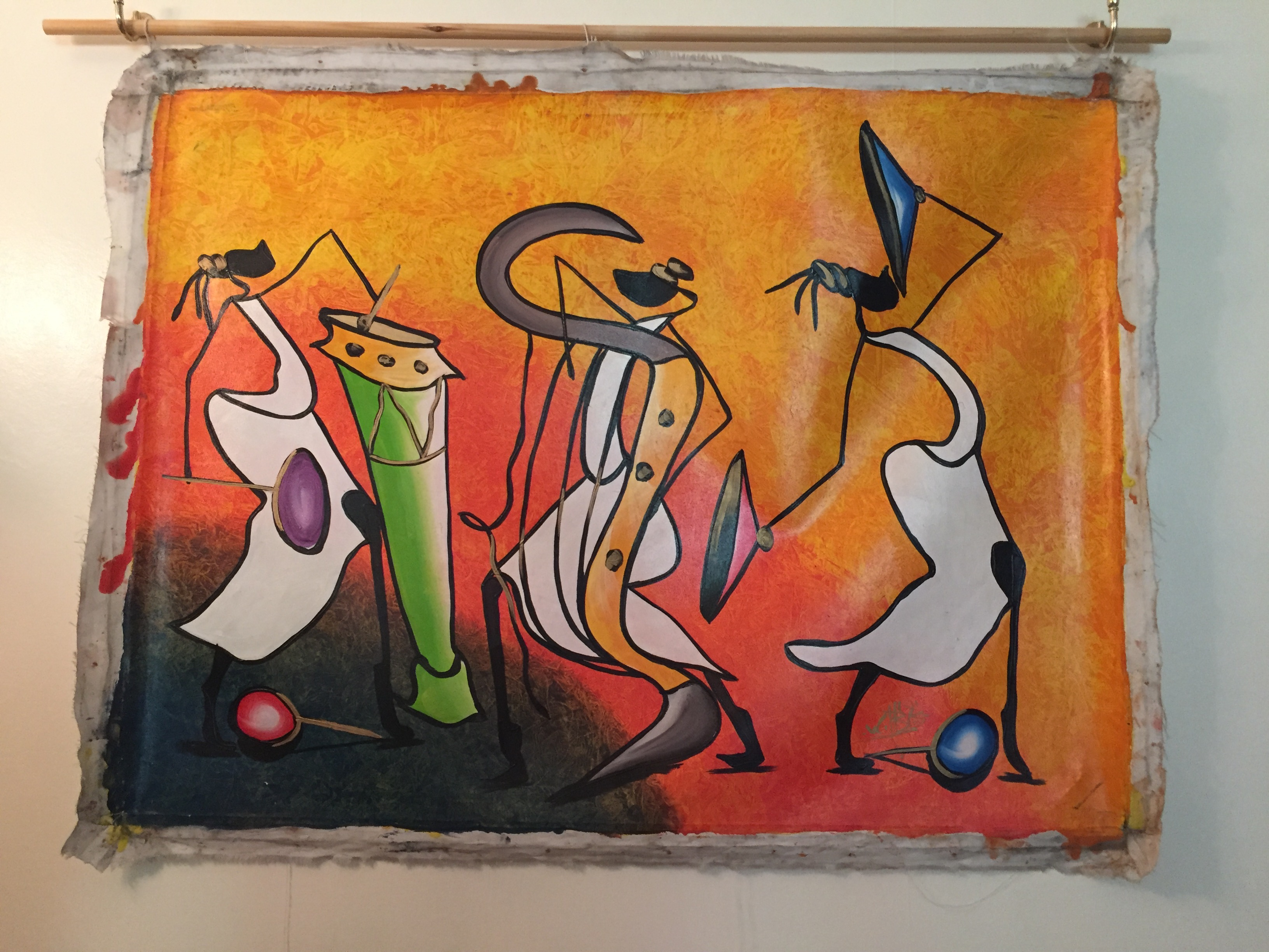 Caribbean art Haitian painting showing three stylised fitures with musical instruments