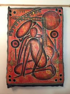 Caribbean art Haitian painting in browns with sitting man amid musical images